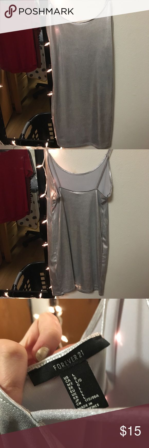 Metallic silver bodycon dress! In perfect condition, bought and washed it for Halloween costume and ended up not wearing it!! Runs kind of small though! Forever 21 Dresses Mini