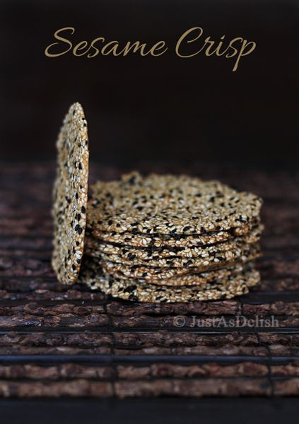 White and black sesame seed crisps, via Shannon Lim on Honest Cooking -- swap buckwheat, sorghum or brown rice flour for AP to make these GF