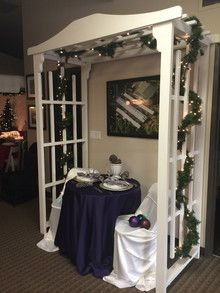 A pergola over an intimate table for two as seen in the Big Top Tent Rentals Christmas showroom!