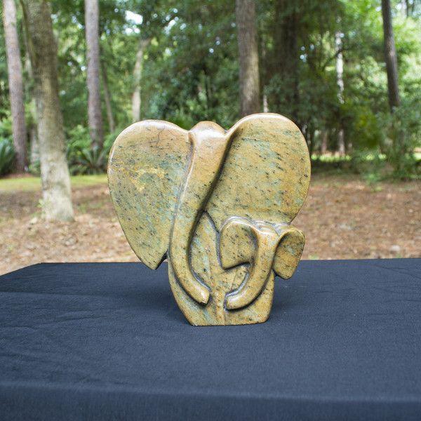 """Abstract Elephant"" Shona Sculpture- Motherandchildwithabeautifulrangeofflecks,specklesandcolours broughtoutofthestonewiththefinalwaxandpolishprocess.Shona artists are well known for their stone sculptures and are typically called ""Shona"" sculptures. 30% of net profits go back to three Zimbabwean charities."