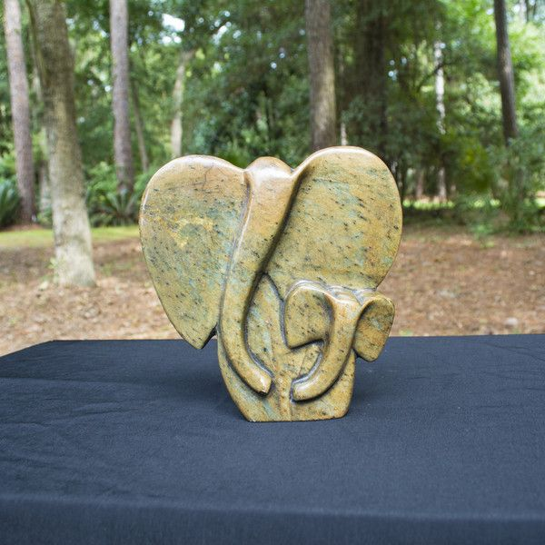 """""""Abstract Elephant"""" Shona Sculpture- Mother and child with a beautiful range of flecks, speckles and colours brought out of the stone with the final wax and polish process.Shona artists are well known for their stone sculptures and are typically called """"Shona"""" sculptures. 30% of net profits go back to three Zimbabwean charities."""