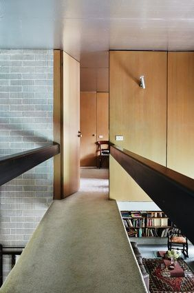 A bridge flies across the double-height void above the dining room to the main…