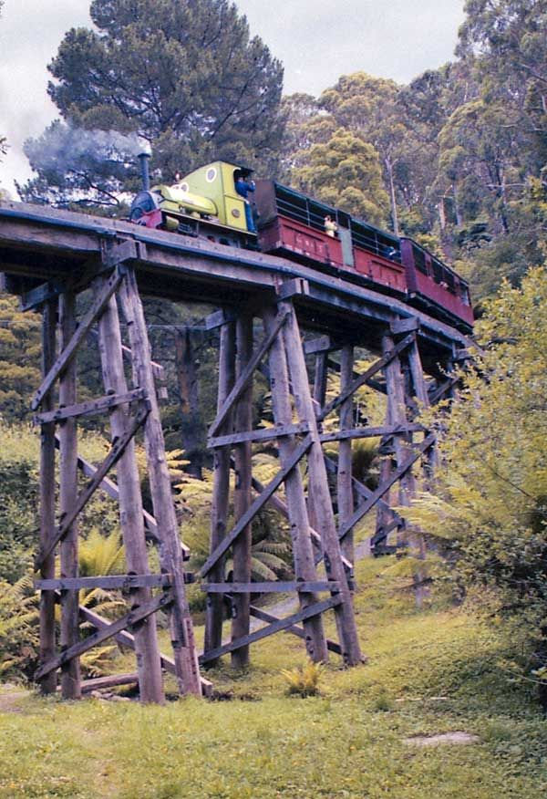 Puffing Billy Dandenong Ranges Victoria Australia Sir John Grice crosses the Monbulk creek trestle bridge near Belgrave on a special two-car train bound for Lakeside, in December 1991. (Sir John Grice is an 0-4-0ST locomotive, and was built in Bristol, England in 1926) photo by Frank Stamford