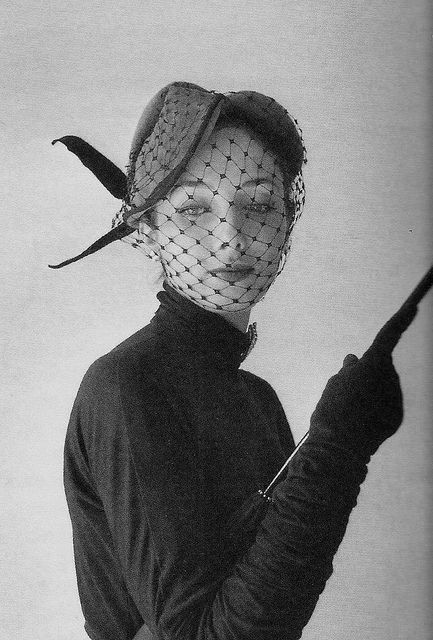1951 pillbox hat with veil and feathers. Designed by Jaques Fath and photographed by Willy Maywald