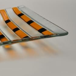 """Decorative handmade plate """"Ape"""" performed by myself in my glass workshop. Plate was done from Baoli fusable and float glass in the glass kiln. It has practical but decorative form combining several colours and shapes. Combine transparent, orange and black colours. As it's a handmade item it has several natural inconsistencies in the structure - makes plate even more natural and beautiful."""
