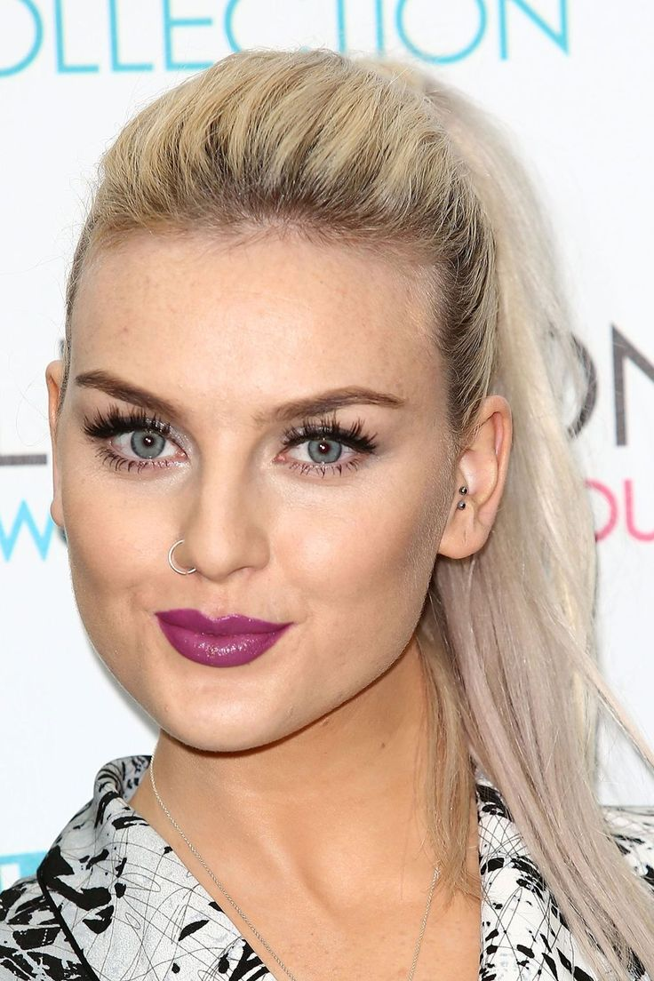 At the launch for Little Mix's makeup range in 2013, Perrie wore her hair in a simple ponytail style to make her bright pinky purple lips pop.