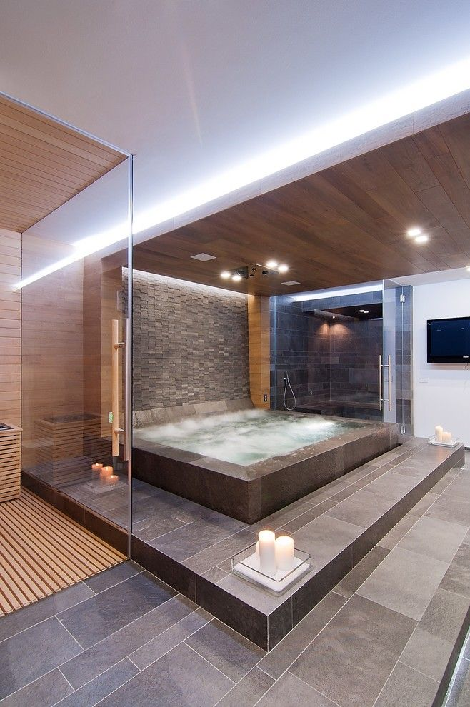 Huge Jacuzzi In The Master Bathroom Surrounded By Stone Tile And Wood  Ceiling, Spa Like