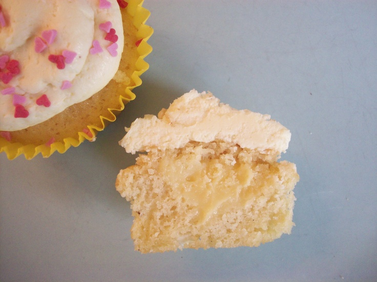 lemon & white choc cupcake - lemon + white choc chip cake, lemon curd filling and white choc buttercream