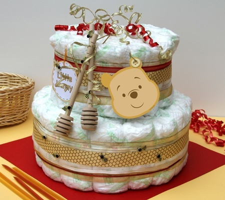 Winnie the Pooh Themed Diaper Cake. Create a two-tired diaper cake with 100 HUGGIES Pure  Natural Diapers adorned with honey-colored ribbons and wooden drizzlers.