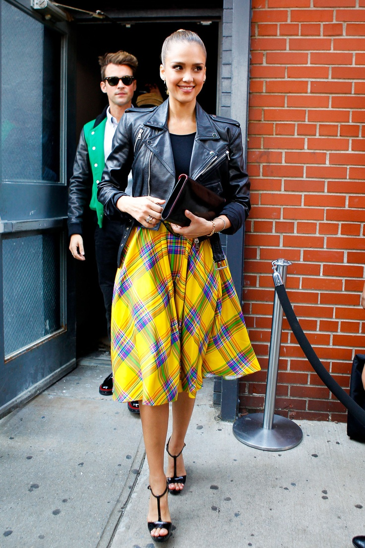 Jessica Alba, with Brad Goreski in tow, wears a yellow plaid skirt and leather jacket as she leaves a fashion show during New York Fashion Week
