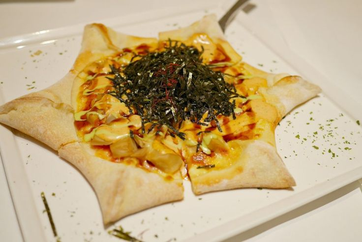 Star-shaped golden pizza -- filled with oyster mushrooms, cream cheese, mustard and wasabi sauces, Thousand Island dressing. Generously topped with thin strips of salted seaweed.