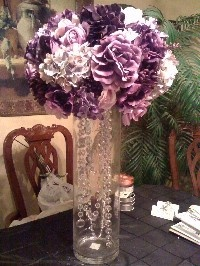 purple centerpiece...I like this for the escort cards or bar