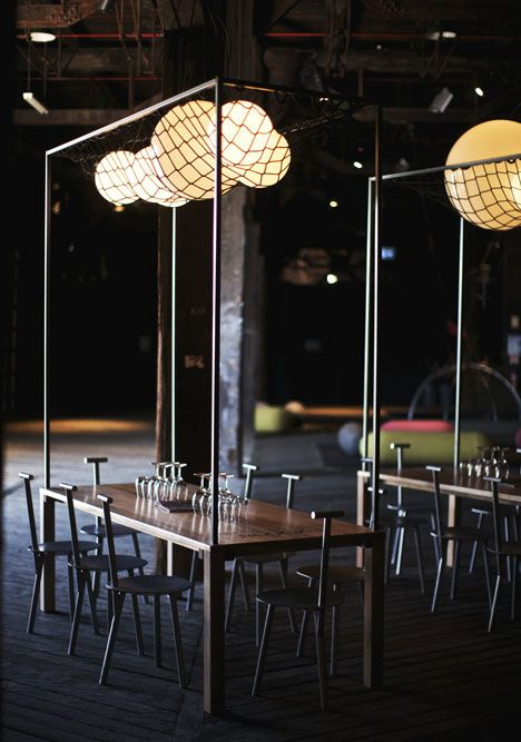 The Blocks by Studio Toogood.  The concept of the frames that hold the light fixtures over the tables can be recreated for a thematic event as the lights could be battery operated...great inspiring design that is Edgy .
