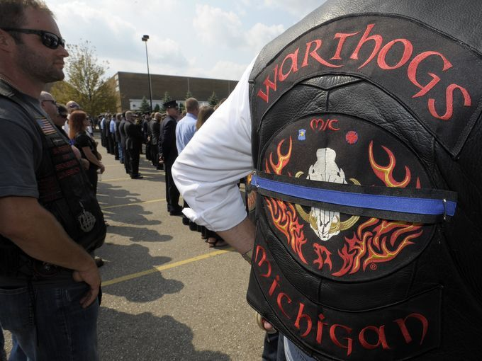 Members of the Warthogs Motorcycle Club wear their | THE ...