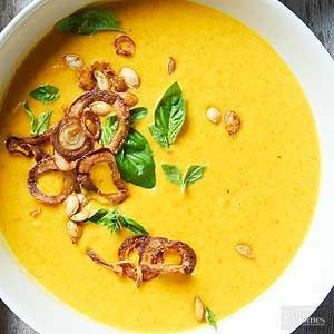 Carrot, acorn squash soup with coconut milk. Top soup with fried onions, basil, and toasted acorn squash seeds. /