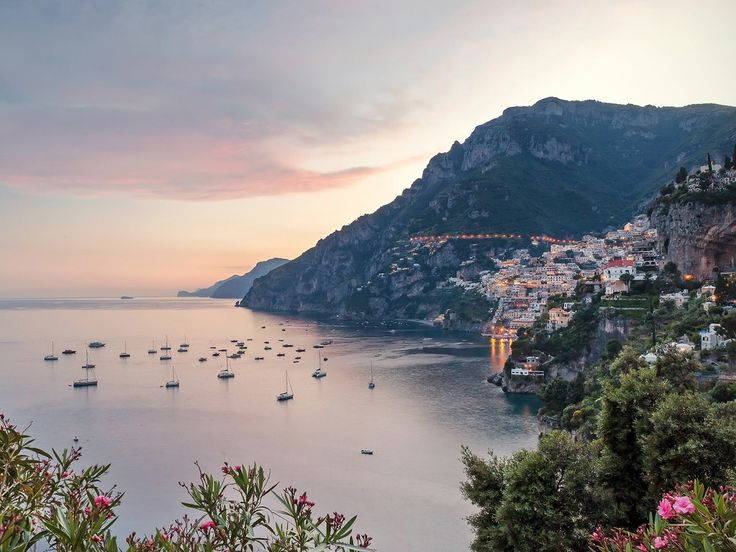 """The Amalfi Coast is postcard-pretty Italy, rimmed by the """"road of 1,000 bends"""" that hugs the top of steep cliffs that plunge into the bright blue waters of the Med, connecting small villages via a landscape of olive groves and lemon trees. But come summertime, unfortunately, the crowds can clog that tiny two-lane road"""