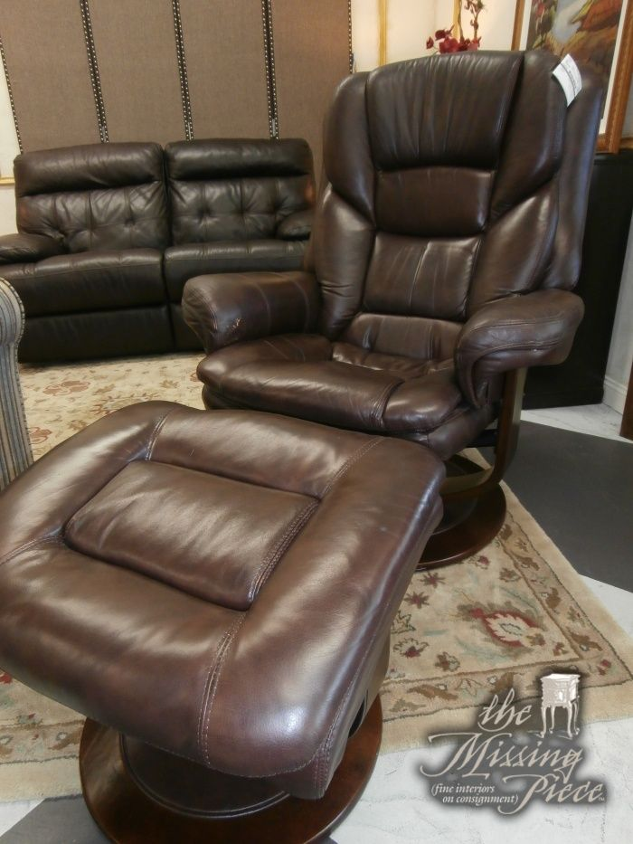 Reclining chair and matching ottoman in chocolate from Ashley Furniture. Measures 33*29*42.