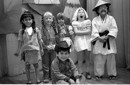 Hubbard Street Elementary kindergarten students participating in an ethnic awareness program, 1977. Sitting: Jerry Ruiz. Also pictured (l-r): Eddie Ramirez, Jennifer Alexander, Nissa Sundberg, Karith O'Keefe, Jason Lopez.. Robert and Betty Franklin Collection. San Fernando Valley History Digital Library.: Students Particip, Elementary Kindergarten, Kindergarten Students