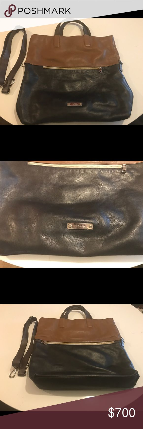 Two-tone leather coach travel bag Coach two-tone leather tote bag that has pockets on each side.  It has removable straps if you just want to carry it by the handles. It is very wide and deep so it can fit a lot of clothes in it. Perfect for traveling. Coach Bags Travel Bags