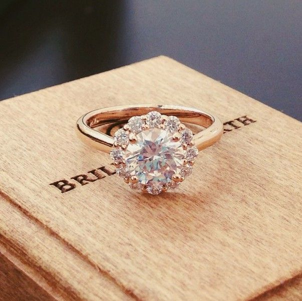 The subtle floral diamond halo blooms around the center diamond in this exquisite Brilliant Earth ring