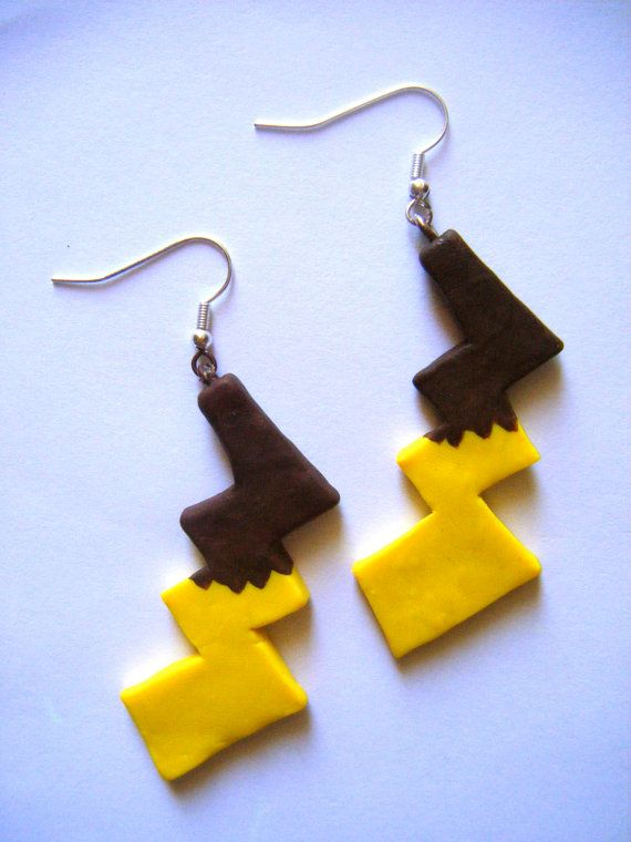 Hey, I found this really awesome Etsy listing at http://www.etsy.com/listing/105015630/pikachu-tail-earrings ERMAGERD I WANTZ