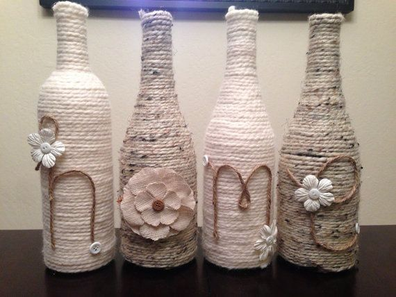 Diy yarn wine bottle crafts with buttons and flowers for Diy wine bottle crafts pinterest