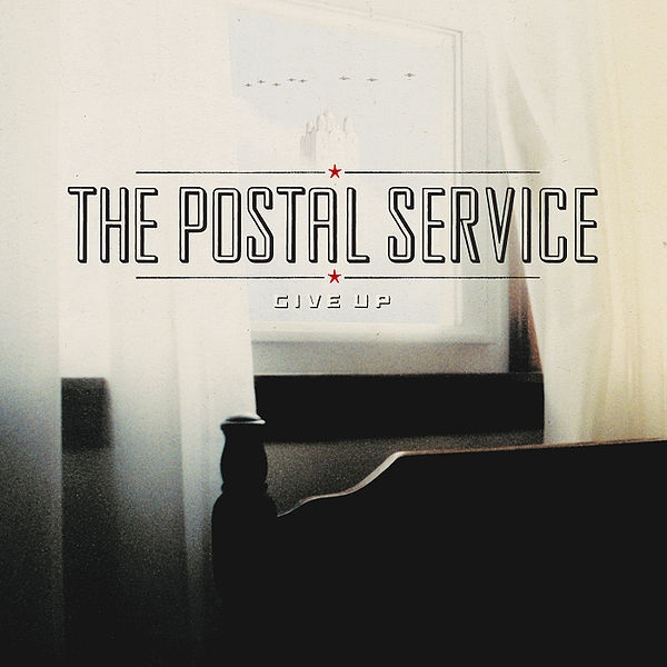 "As you may have heard, super group Postal Service is back with a new album.  Watch the first single, ""A Tattered Line of String"" right here."