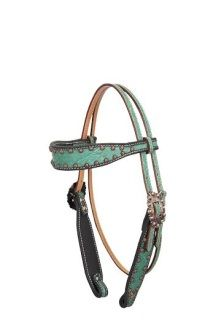 This teal elephant browband headstall with copper bullets is a new addition to our exotic print headstalls and would be great for any tack collection.