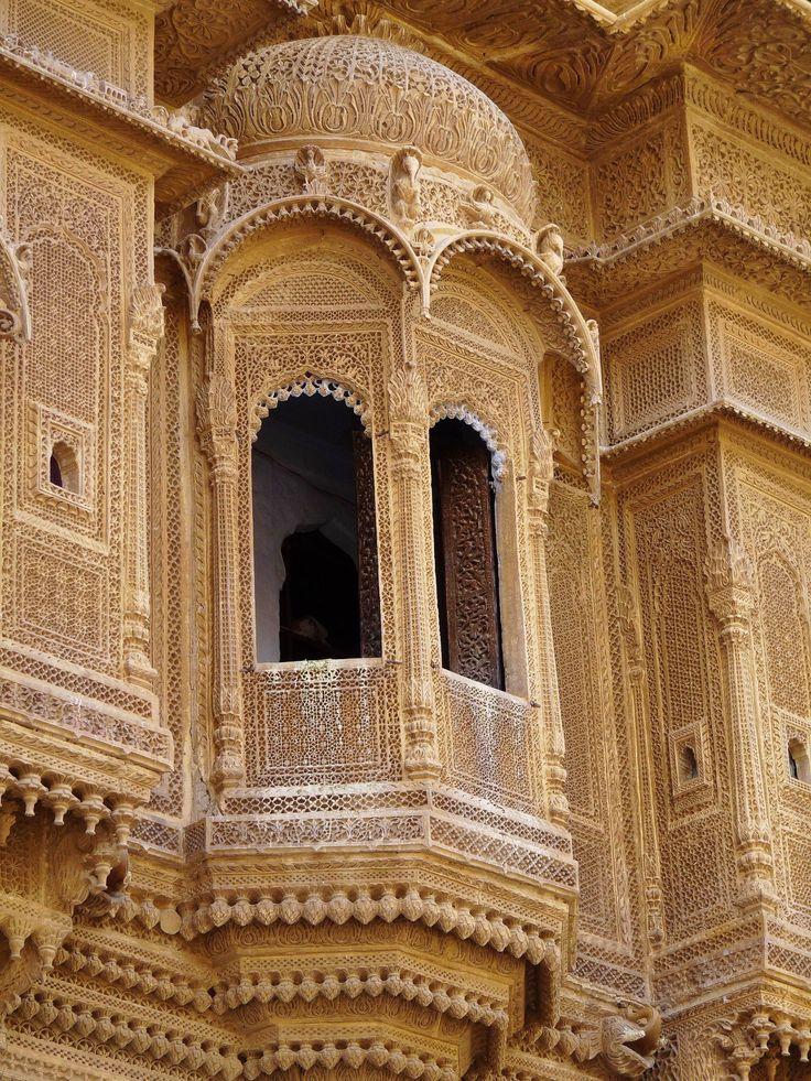 Intricate sandstone carvings of bay windows on royal palace inside Jaisalmer Golden Fort