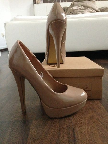 Patent leather nude heels.  EVERY female that can properly walk in heels needs these in her closet!!!! They look good with every color....& they are complimentary to the legs. Ladies....please...please....PLEASE say NO to white shoes....opt for the nude, you can not go wrong. :)