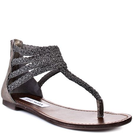 Put a fabulous flair to your warm weather outfit in this stylish Steve  Madden flat. Symon G features pewter braided straps with a man made lining.
