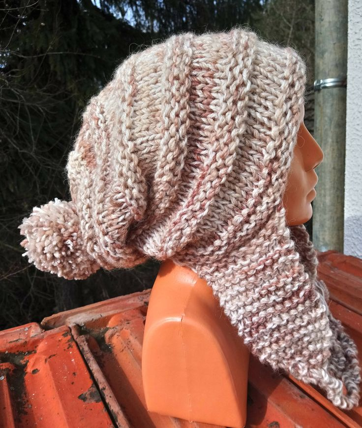 Excited to share the latest addition to my #etsy shop: Chunky knit pom pom slouch hat - chunky knit earflap hat - Hand knitted trapper style hat - Beige and brown chunky knit hat with braids http://etsy.me/2CyNLSi