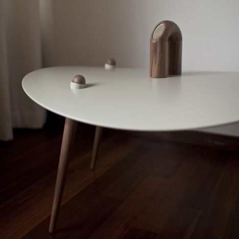 I was sold on the wood and white, I also love how the legs come up through the table, and that curve