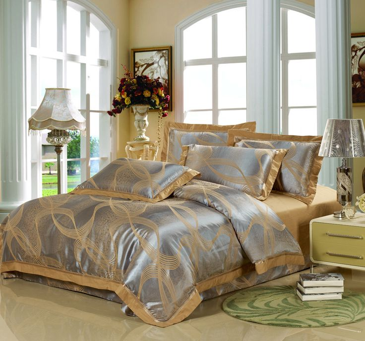 deluxe gold and silver bedding set and elegant standing lamp