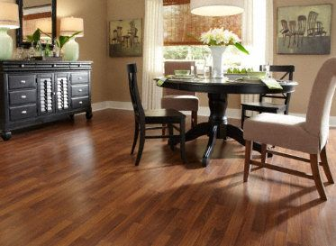 Paint Rock River Walnut adds subtle character to this dining room. Get the look of hardwood with a Dream Home #Laminate!