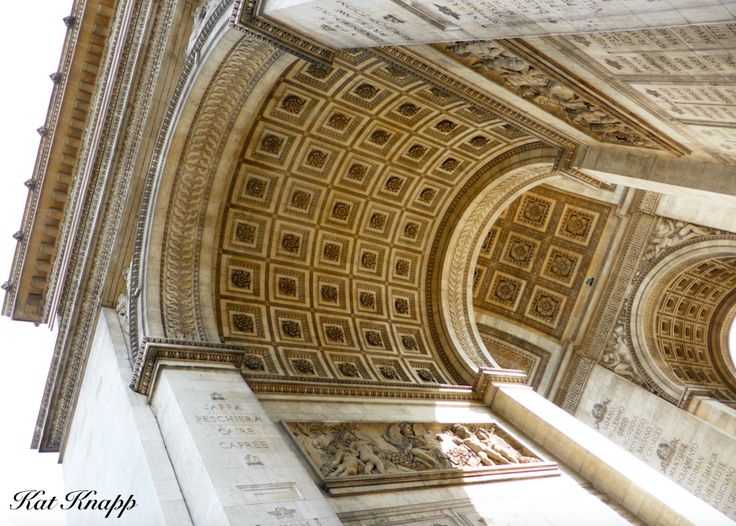 Looking up at the Arc de Triomphe in Paris