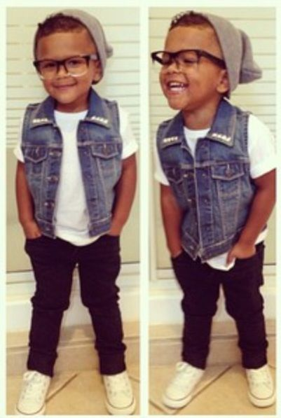 Baby swag! blue jean vest, black jeans and skull cap; black glasses & high top tennis shoes;