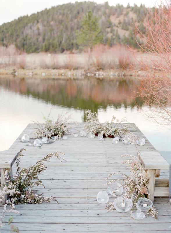 14 Ideas We Are Loving for Winter Weddings | Ice Sculpture Votives | Venue: The Ranch at Rock Creek | Photo: Jose Villa