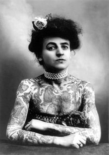 American woman in 1907 with arms and chest covered with tattoos