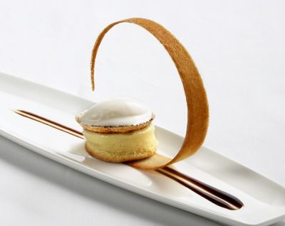 The large, curved tuille cookie s a great way to add drama to an otherwise simple plating.
