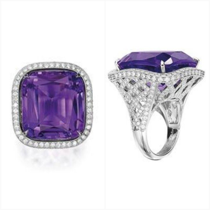 Amethyst and Diamond Ring, by ASPREY . Centring on a cushion-shaped Amethyst weighing approximately 41.05 carats, to a stylised basket decorated with brilliant-cut Diamonds extending to the shoulders, the Diamonds together weighing approximately 3.70 carats, mounted in Platinum, signed. Ring size: 7½.
