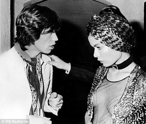"""""""Put a bra on!"""" Mick Jagger and his then wife Bianca, pictured after their St Tropez wedding in 1971, modelling one of her revealing tops."""