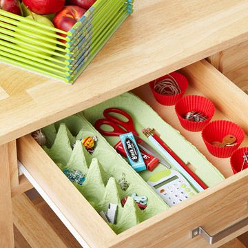 Top-Drawer Solution: Control clutter in a junk drawer. Silicone cupcake liners hold small, loose items. An egg carton stashes items such as thumb tacks and staples in the egg cups and larger items such as pencils, a calculator, and a pair of scissors on the other side. The countertop basket is made from repurposed chopsticks.