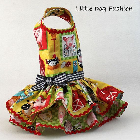 * Dog fashion for small dog, handmade dress for dogs * Ruffle dress for dog features a farm animals theme, cute cow print on yellow background * Dog harness dress is deocrated with ric rac trim * Dog dress features a double ruffle and is very full * Closes around neck and girth with velcro * d ring for easy leash attachment * Custom made * Made to order * Please include the neck, girth and length measurements in the comment section during check out