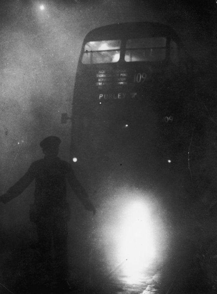 9 December 1952: A bus conductor walks in front of his vehicle. | 26 Haunting Photos Of The London Fog