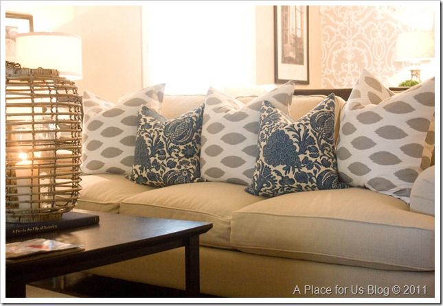 Nice updated pillows mixing the grey and blue for a beige couch.