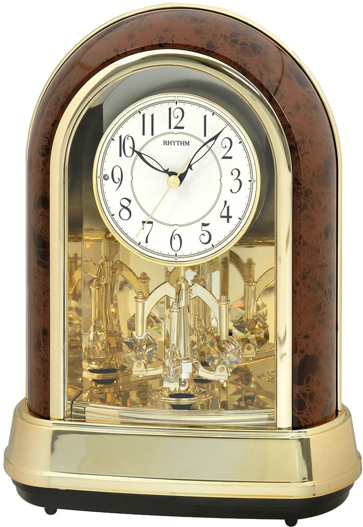 Rhythm Torsion-Pendulum-Table-Clock with Chime  Plastic housing MADE WITH SWAROVSKI ELEMENTS  30 Melodies & 6X-mas Songs  chime hourly  Clarion Tone System  Batteries: 4 standard AA  automatic night-shut-off via light sensor  made in japan  2 years guarantee  volume control