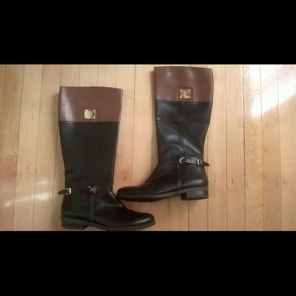 New Tommy Hilfiger boots Tommy Hilfiger black and brown boots with gold detail, very cute. I had to buy them, but they were never used, tag is still on. small spot on top as shown in picture, bought like that. Price is negotiable through offer button.  No trades. I am happy to answer questions and entertain reasonable offers. It doesn't have a box. Tommy Hilfiger Shoes Winter & Rain Boots