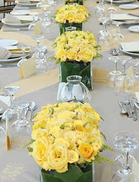 Yellow Skyline Roses are perfect for summer wedding centerpieces #calyx #wedding #flowers