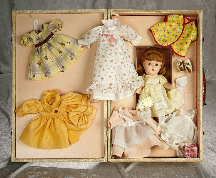 """16"""" (41 cm.) All composition with socket head and five piece body, sleep eyes, freckles, auburn human hair. The doll is presented in her original show box, wearing original costume, along with an assortment of additional costumes (three with original """"Alexander, Flora McFlimsey"""" labels). Generally excellent. Alexander, circa 1935, McGuffey Ana."""